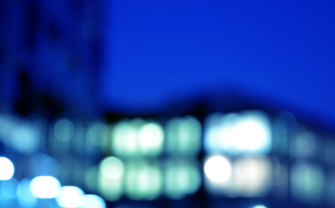 Blurred Night Architecture - Building With Glass Facade. Modern